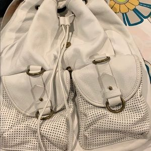 Joelle Hawkens white leather backpack